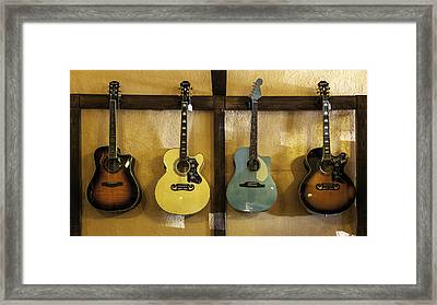 Festive Acoustic Guitars All In A Row Framed Print