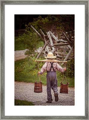 Fetch A Pail Of Water Framed Print by Chris Bordeleau