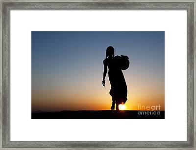 Fetching Water Framed Print