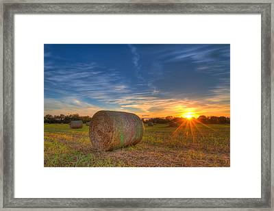 A Hay Bale Sunset Framed Print by Tim Stanley