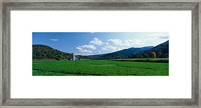 Field With A Silo In The Background Framed Print by Panoramic Images