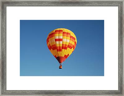 Fiery Balloon Framed Print by Miguelito B