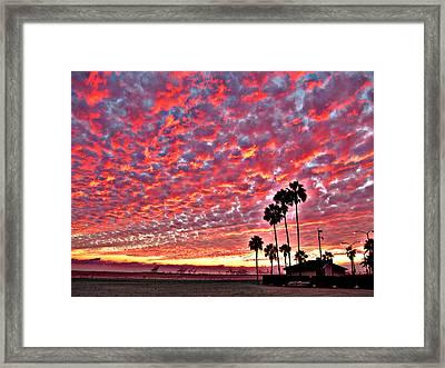 Fiery Clouds Framed Print by Raymond Mendez