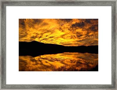 Fiery Sunrise Over Medicine Lake Framed Print by Rich Rauenzahn