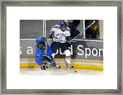 Fighting For The Puck Framed Print