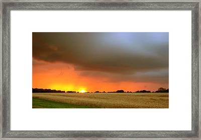 Fighting Sun Framed Print by Dave Woodbridge