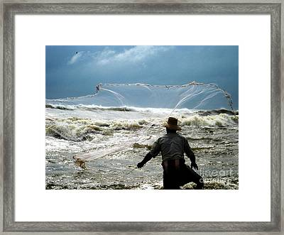 Fisherman Fighting With Waves Framed Print by Surendra Silva