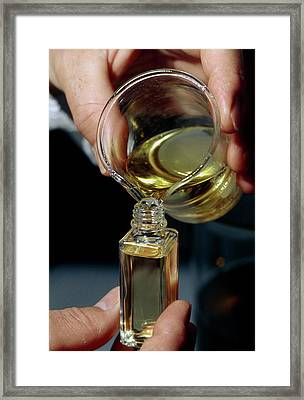 Filling A Sample Bottle With Perfume From A Beaker Framed Print by Klaus Guldbrandsen/science Photo Library