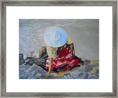 Finding Seashells Framed Print by Joyce Reid