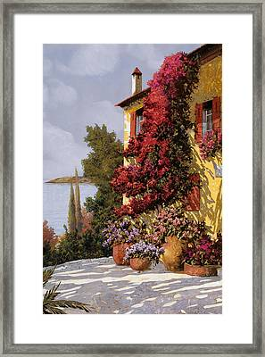 Fiori Rosssi E Muri Gialli Framed Print by Guido Borelli