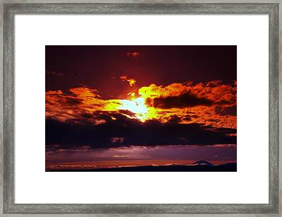 Fire In The Clouds Framed Print by Jeff Swan