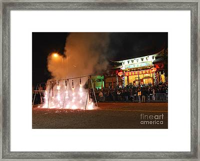 Firecrackers At Night During The Chinese New Years Celebration. Framed Print by Jamie Pham
