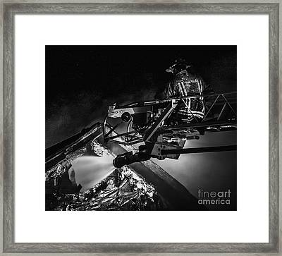 Firefighter At Work Framed Print