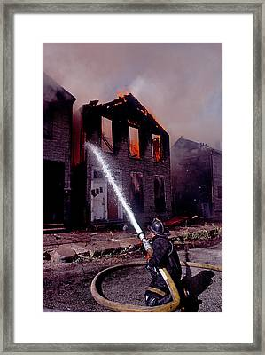 Firefighter During A Rescue Operation Framed Print by Panoramic Images