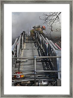 Firefighter On Telescopic Ladder Framed Print by Jim West