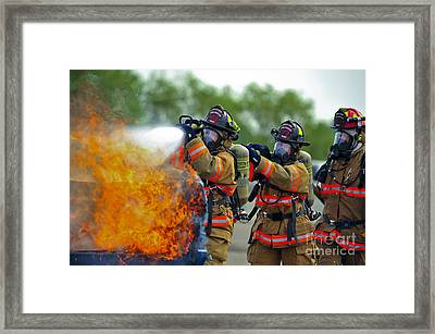 Firefighters Put Out A Fire Framed Print by Stocktrek Images