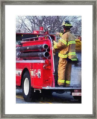 Fireman On Back Of Fire Truck Framed Print