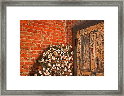 Firewood And Door Framed Print
