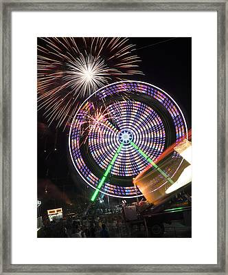 Fireworks Bursting Over A Ferris Wheel Carnival Ride Framed Print