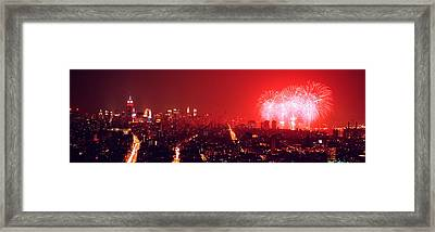 Fireworks Display At Night Over A City Framed Print