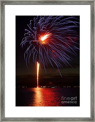 Fireworks Over Lake Framed Print by Raymond Earley