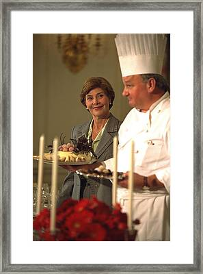First Lady Laura Bush And White House Framed Print by Everett