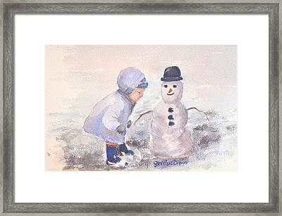 First Snowman Framed Print