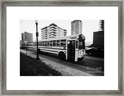 first student canada yellow school bus Saskatoon Saskatchewan Canada Framed Print by Joe Fox