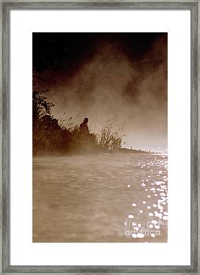 Fisher In The Mist Framed Print