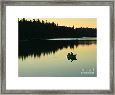 Fisherman At Dusk Framed Print