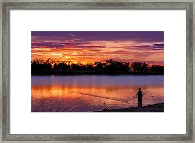 Fisherman At Sunrise Framed Print