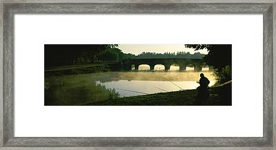 Fisherman Fishing In A River Framed Print by Panoramic Images