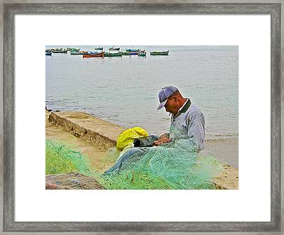 Fisherman Mending Nets In Chorillos Area Of Lima-peru Framed Print by Ruth Hager