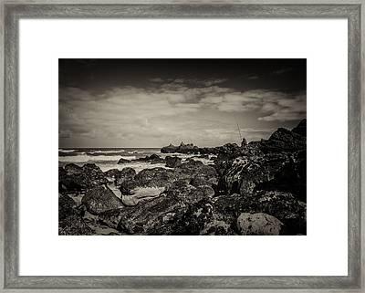 Fisherman On The Rocks Framed Print