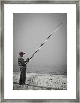 Fisherman Framed Print by Tom Hudson