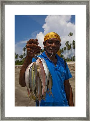 Fisherman With Catch In Indonesia Framed Print