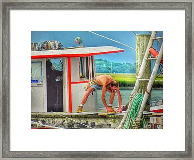 Fisherman Working On His Boat Framed Print by Patricia Greer