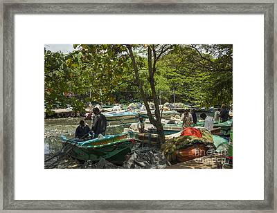Fishermen And Their Boats Framed Print