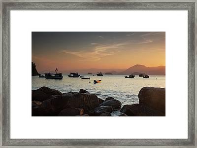 Fishermens Boats Float Off The Coast Framed Print