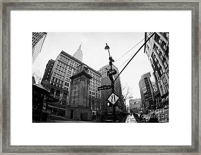 fisheye shot of Herald Square Macys and Broadway from 35th Street in the rain and empire state build Framed Print by Joe Fox