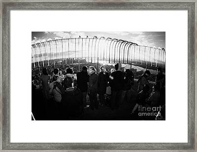 Fisheye Shot Of Sightseers Look At The View From Observation Deck 86th Floor Empire State Building Framed Print by Joe Fox