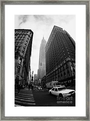 Fisheye Shot Of Yellow Cab And Empire State Building At Intersection Of 34th Street Broadway 6th Framed Print by Joe Fox