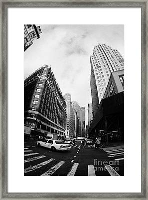 Fisheye Shot Of Yellow Cab On Intersection Of Broadway And 35th Street At Herald Square New York Framed Print by Joe Fox