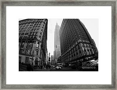 fisheye shot View of the empire state building from West 34th Street and Broadway junction Framed Print by Joe Fox