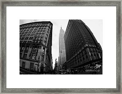 fisheye shot View of the empire state building from West 34th Street and Broadway new york city Framed Print by Joe Fox