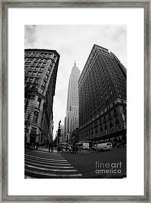 fisheye shot View of the empire state building from West 34th Street and Broadway new york usa Framed Print by Joe Fox