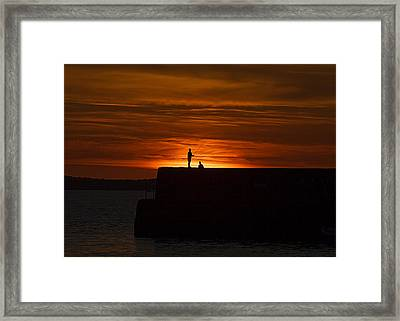 Fishing As Sunset Framed Print by Tony Reddington