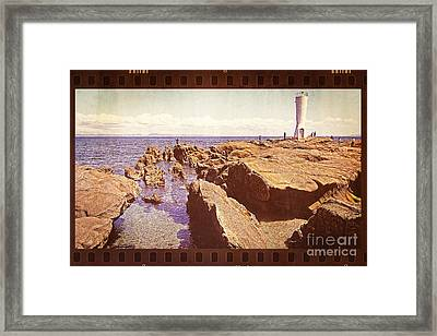Fishing At Noon By The Lighthouse Framed Print by Beverly Claire Kaiya