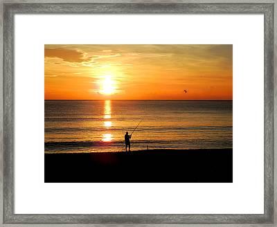 Fishing At Sunrise Framed Print