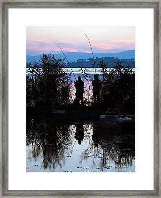 Fishing At Sunset Framed Print by Tim Holt